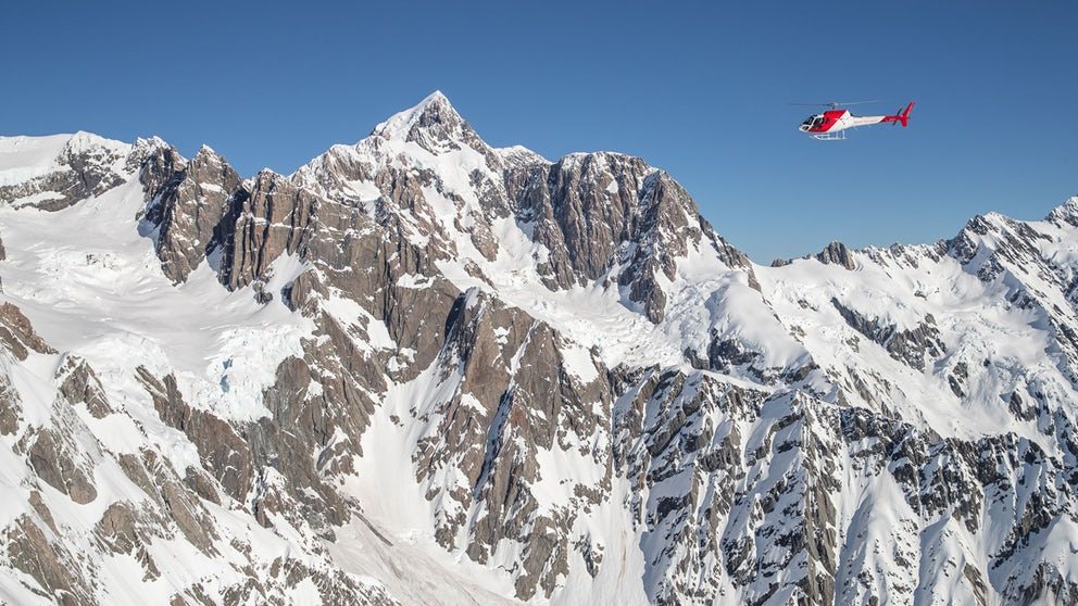 Helicopter Flying Close To The Summit Of Mount Cook