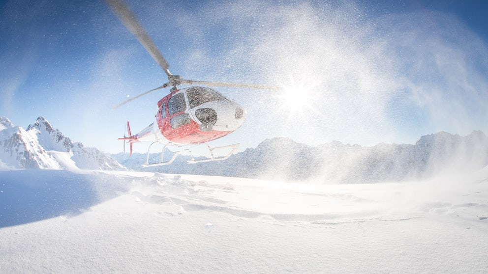 Helicopter Blowing Snow Around Whilst Landing