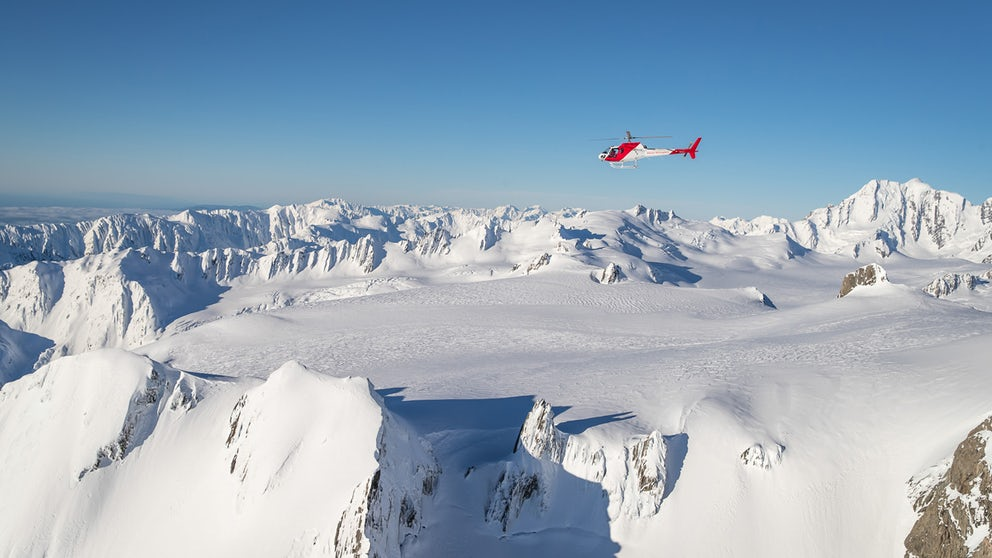 Helicopter Scenic Flight Above A Glacial Neve