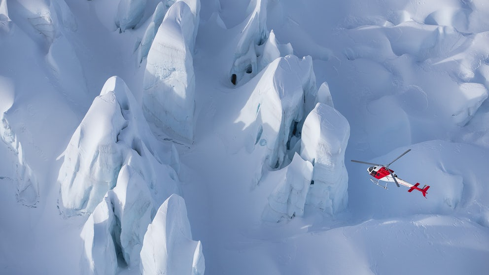 Towering Ice Structures Beneath Helicopter