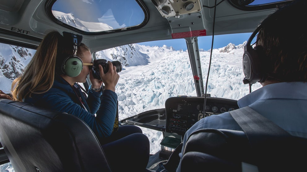 Passenger Taking Photos From The Front Seat Of A Helicopter